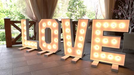 оформление : Illuminated love letters. Light letter sign on floor. Strong feeling that unites people.
