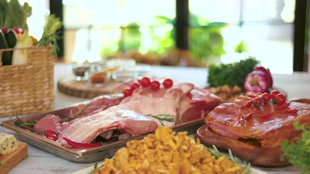 veal recipe : Wooden table with food. Fruits, roquefort cheese and meat. Blend the tastes.