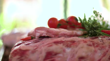veal recipe : Raw meat pieces and tomatoes. Vegetables, herbs and ice. Cook steaks and chops.