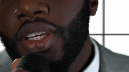 estréia : Afro-american man singing isolated. Closeup of guy holding microphone. Single from debut album. Vídeos