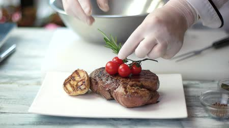 dish : Grilled meat with vegetables. Hand of chef decorating food. Steak presentation ideas. Stock Footage