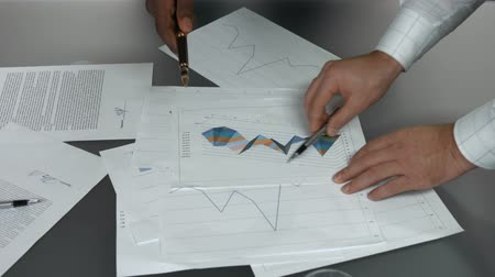 analiz : Business charts and hands. Papers with graphs. Stok Video