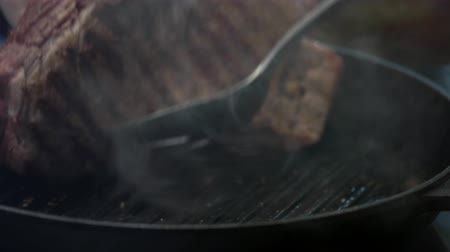 veal recipe : Steak on frying pan. Grilled meat close-up. Juicy veal with spices. Stock Footage