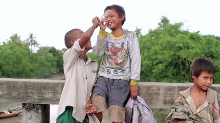 asian and indian ethnicities : Poor, dirty, funny kids living in Myanmar. Stock Footage