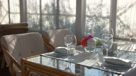 столовая : Dinner table near window. Cutlery plates and glasses.