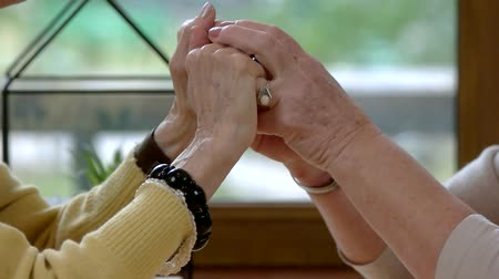strong granny : Senior ladies holding hands. Two old women. Friend will always support you. Stock Footage