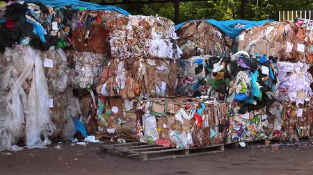 plastics : bulldozer packs up waste for recycling