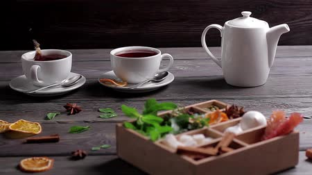 bizet : Adding sugar and mint into tea. Wooden box with mixed spices. Stock Footage