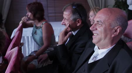 spaniard : Kiev, Ukraine 25.08.2012. Spaniards sit at the wedding ceremony. Positive laughing men. Stock Footage