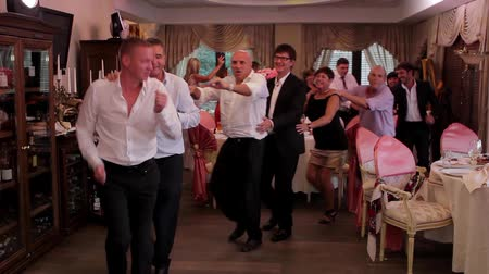 spaniard : Kiev, Ukraine 25.08.2012. Guests dancing at a wedding. People dancing in the restaurant. Stock Footage