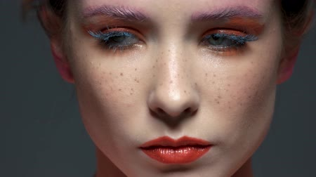 eyeshadow : Female face, beautiful artistic makeup. Serious woman close up.