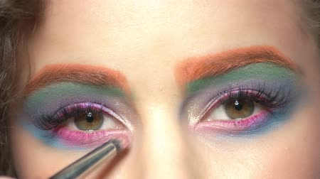 paleta : Beautiful eye makeup. Brush of visagist eyeshadow.