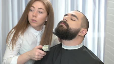 barbering : Beard grooming process. Female barber at work. Basics of barbering. Stock Footage