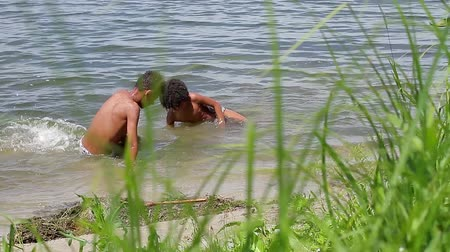 týmy : Two mulatto swimming in the river. Hot Africa.