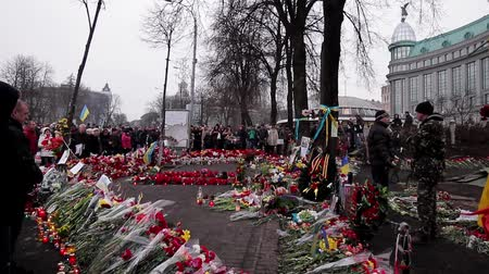 heroes square : People lay flowers for heroes. Day of mourning for the dead. The uprising in Ukraine in 2014.