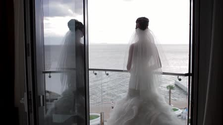 fidelity : Bride on the terrace waits the groom. Bride standing on the balcony. Stock Footage