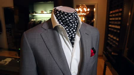 showcase : Stylish mens suit. Mens jacket on a mannequin. Mens Clothing. Mannequins in the window of the boutique. Clothing store. Shopping in boutiques.