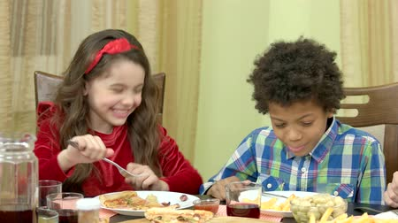 rekomendacja : Boy and girl eating. Kids at the table. Nutrition recommendations for children.