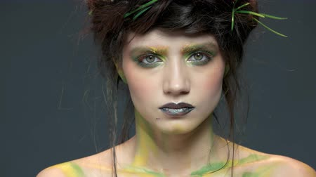 pszichológia : Serious face of young woman. Young makeup model.