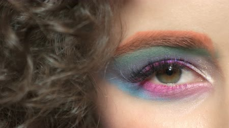 eyeshadow : Female eye and hair, makeup. Pink and blue eyeshadow. Marketing ideas for cosmetics company. Stock Footage