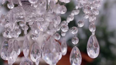 white cloths : Beautiful crystal chandelier with a light cloth on the wedding ceremony. Wedding day. Stock Footage