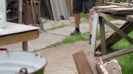 slum : Old man walking on the yard. Rural grandfather. Legs of old man. Stock Footage