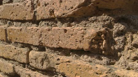 antique grunge : Ancient wall and sunlight. Damaged bricks and cement. Architecture of old world. Stock Footage