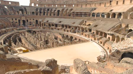 flavian : Inner part of Colosseum, people. Ancient landmark of Rome. Stock Footage