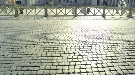 paving blocks : Paving stones, Saint Peter square. Pavement and sunlight. Small pieces of big history. Stock Footage