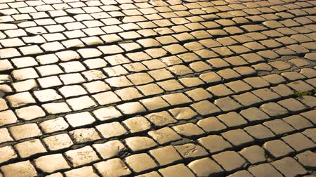 paving blocks : Paving stones texture. Square stones and sunlight. Stock Footage