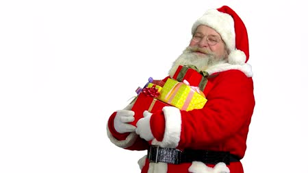 lenda : Santa holding presents isolated. Santa Claus laughing, white background.