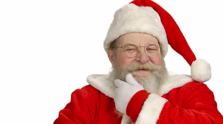 mito : Cheerful Santa on white background. Santa Claus touching his beard. Vídeos