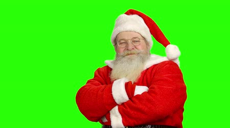 crossed : Santa showing thumbs up, chromakey. Santa Claus, green background.