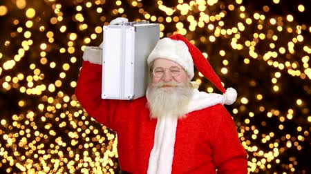 aluminium : Santa Claus holding a briefcase. Santa on blurred lights background. Wideo
