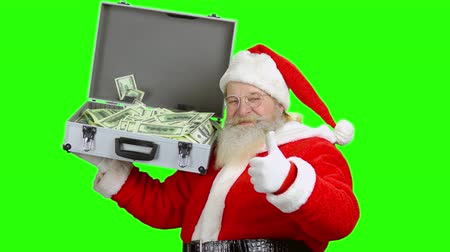 dava : Santa holding money suitcase, chromakey. Santa Claus showing ok gesture.