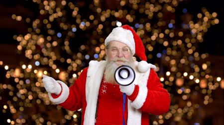 megafon : Santa with megaphone. Santa Claus, bokeh lights background.