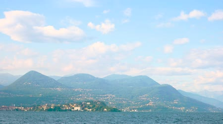 village life : Maggiore lake, Alps and sky. Beautiful landscape, summer. Geography of Italy. Stock Footage