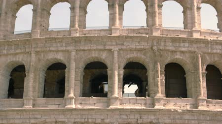 might : Arches of Colosseum. Beautiful ancient building. History of Roman Empire.