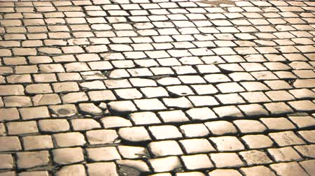 valoun : Old paving stones texture. Road surface and sunlight.