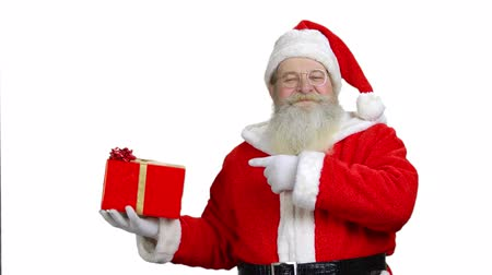 intrigue : Santas promising the present is good. Santa with gift in front of a white background. Stock Footage
