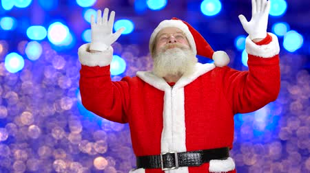 santaclaus : Santa is doing some magic. Christmas is coming. Blue lights behind the santa. Stock Footage