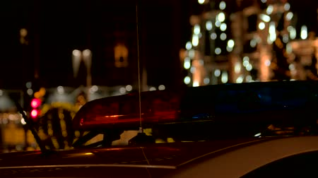 fire officer : Police car siren flashing blue. Disabled red siren. Slowly moving camera. Stock Footage