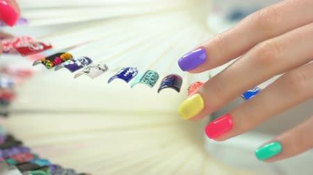 dokonalost : Beautiful summer manicure and nail art samples. Nail art design palette and well-groomed young woman hand close up.