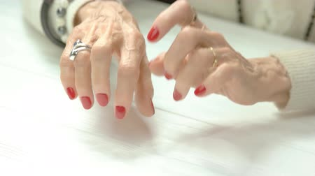 move well : Female fingers imitating play on piano. Elderly woman well-groomed manicured hands moving with fingers as playing on piano instrument in beauty salon on table. Stock Footage