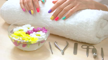chrysanthemum : Female hands receiving spa treatment. Female hands with fresh summer manicure on white towel afte spa. Skin care and spa therapy.