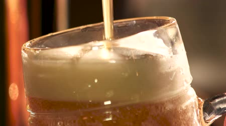 frothy : Beer foam overflowing, close up. Top of frothy beer overflowing, macro view. Stock Footage
