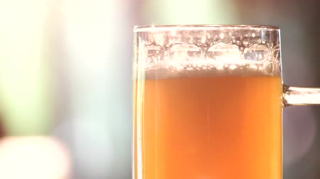 overfill : Close up glass of light ale rotating. Glass of fresh brewed craft lager beer. Stock Footage