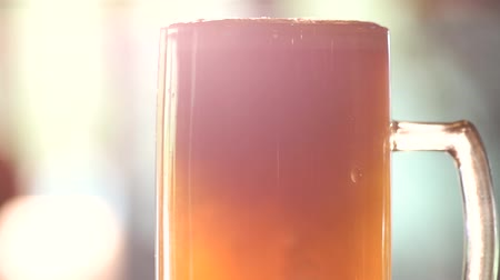 overfill : Close up head of beer pouring. Turbid ale pour in a pint, close up.