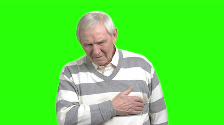pena : Old man has heart attack. Grandpa touching his chest and going to die, green hromakey background.
