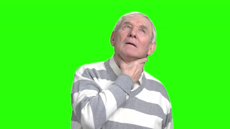 endure : Old man has thore throat and coughing. Grandpa got a flu, green hroma background.